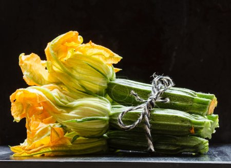 Fresh zucchini with flowers