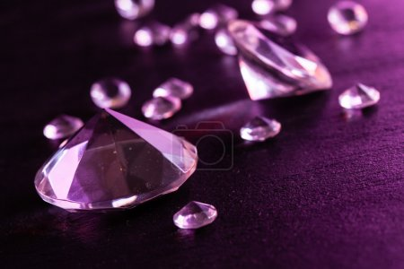 Different diamonds with purple light