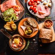 Spanish dinner cooked and served on table, close u...