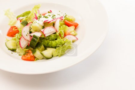 Photo for Spring salad with lettuce leaves - Royalty Free Image