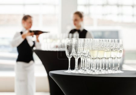 champagne glasses with waiter