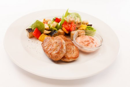 Cutlets with vegetables and sauce