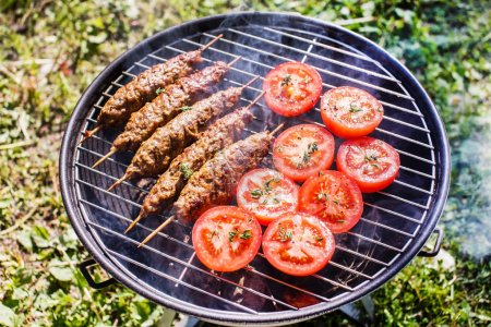 Grilling kebabs with tomatoes