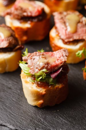 Canapes with beef meat