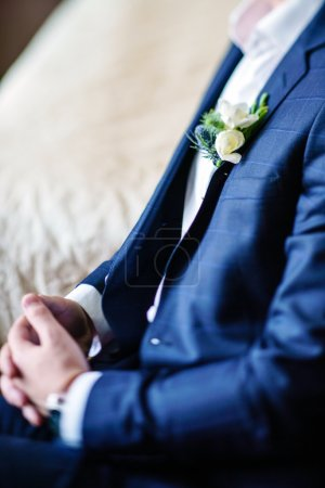 Elegant groom with floral boutonniere