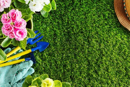 Photo for Garden equipment with spring flowers - Royalty Free Image