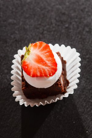 Photo for Tasty brownie cake with strawberry - Royalty Free Image