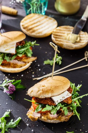 Photo for Tasty burger on dinner table - Royalty Free Image