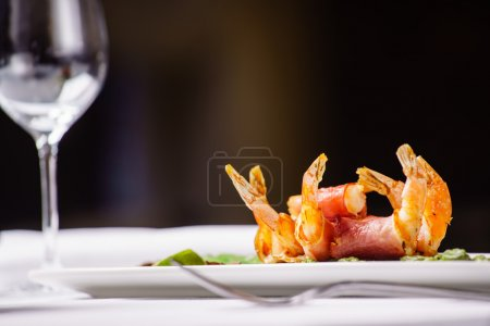 shrimps with asparagus on plate