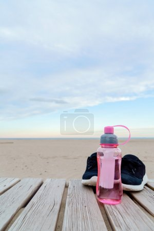 Water in bottle and sport shoes