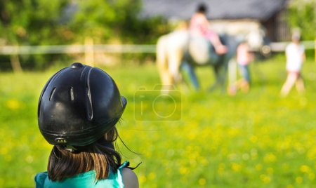 Children riding horse
