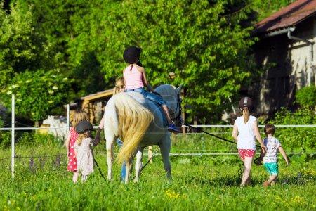 Children riding horse