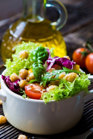 Photo for Fresh mixed vegetable salad with chickpea in white bowl - Royalty Free Image