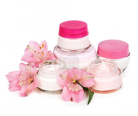 Cosmetic cream and flowers