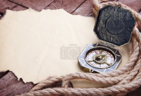 Photo for Vintage compass on the paper and marine ropes. - Royalty Free Image