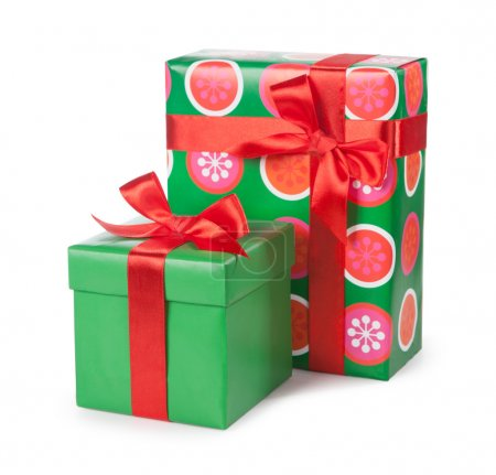 Boxes with gifts tied with red ribbon and bows isolated on white