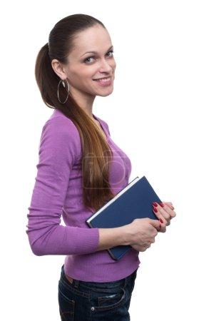 Photo pour Jeune fille avec livre isolé sur un fond blanc - image libre de droit