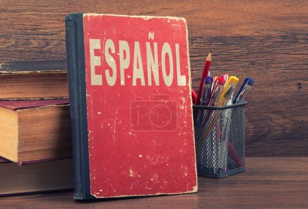 Learn spanish concept. book on a wooden background...