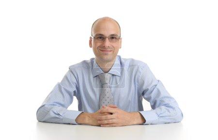 Handsome businessman sitting at a desk