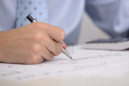 Male hand with pen