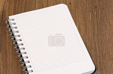 Photo for Open Spiral Notebook with copy space on wooden background - Royalty Free Image