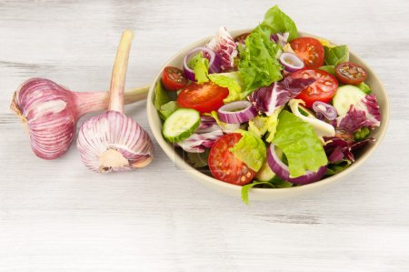 Photo for Fresh vegetable salad in a bowl close up - Royalty Free Image