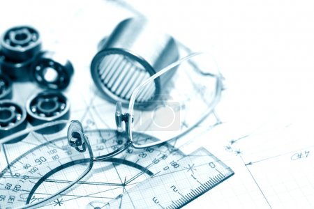 Photo for Industrial concept. Few ballbearings near ruler and spectacles on graph paper background - Royalty Free Image