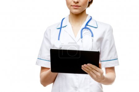 Woman doctor standing on white background