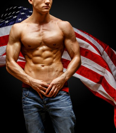 Handsome young mans torso covered with american flag