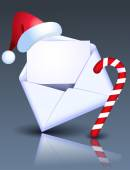 Open Christmas envelope with Christmas candy and Santa hat