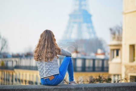 Girl outdoors near the Eiffel tower, in Paris
