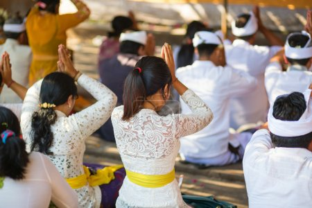Young Balinese women praying in a temple