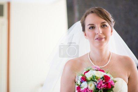 Bride holding beautiful wedding bouquet