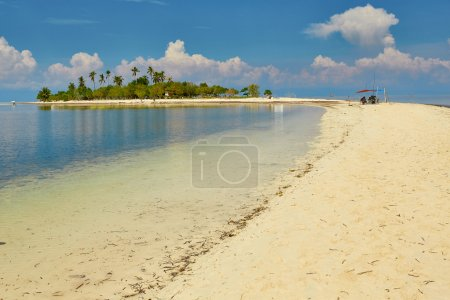 Perfect tropical island with long tongue of sand