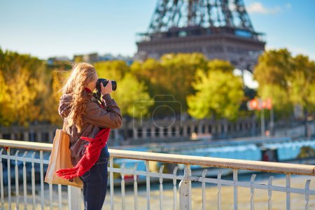 Photo for Young photographer taking picture of the Eiffel tower in Paris - Royalty Free Image