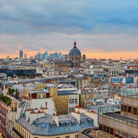 Parisian skyline with Saint-Augustin church at sunset