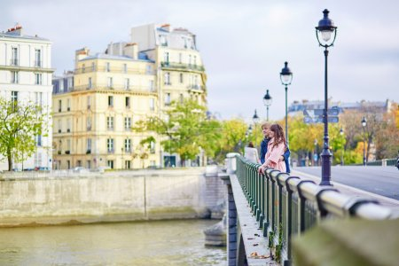 Dating couple on a bridge in Paris
