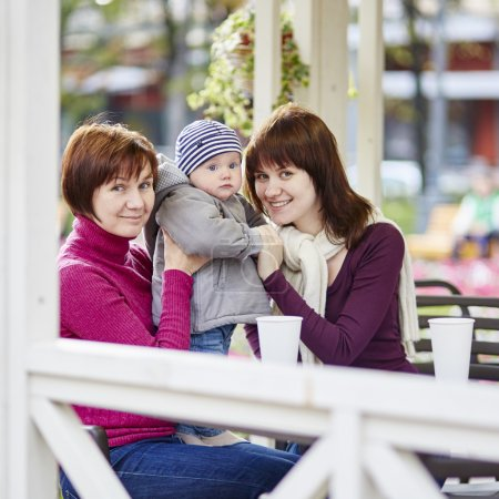 Grandmother, mother and grandson in a cafe