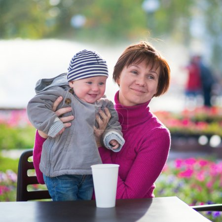 Middle aged woman and her little grandson