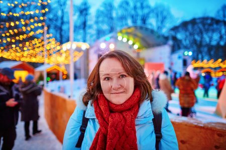 Cheerful young girl on the Christmas market