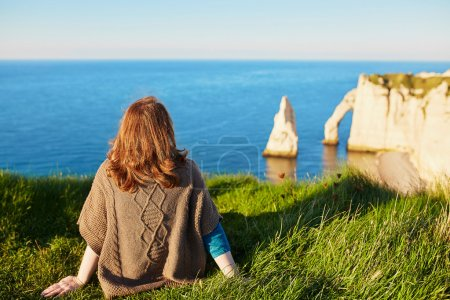 Girl in Etretat, sitting on top of hill