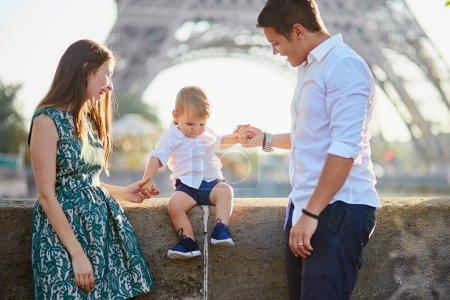 Happy family of three enjoying their vacation in Paris