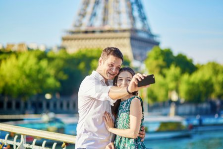 Young romantic couple spending their vacation in Paris