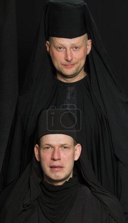 Men in a monk robe.
