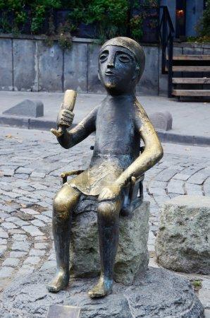 :Bronze statue of sitting Tamada with wine horn on Sioni's street in old Tbilisi, Georgia.Tamada is a Georgian toastmaster at a Georgian Supra (feast)