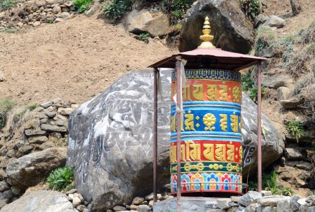 Old buddhist mani stones prayer wheels with sacred mantras on the way to Everest Base Camp, Nepal,Asia,Himalaya