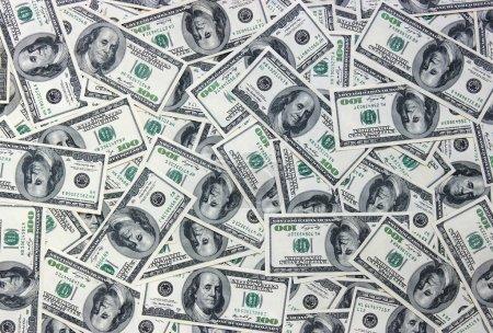 Photo pour Les nombreux dollars. fond argent - image libre de droit