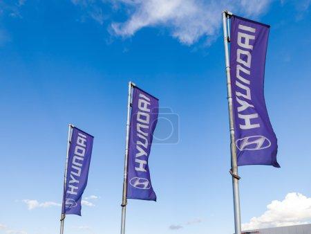 SAMARA, RUSSIA - AUGUST 30, 2014: The flags of Hyundai over blue