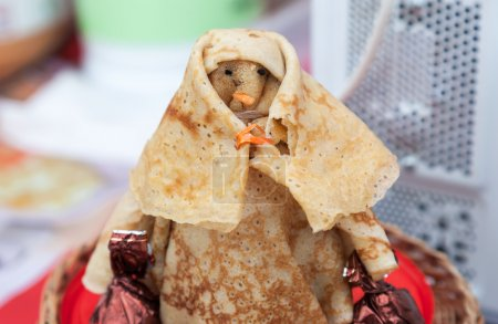 Shrovetide effigy made of pancakes close up
