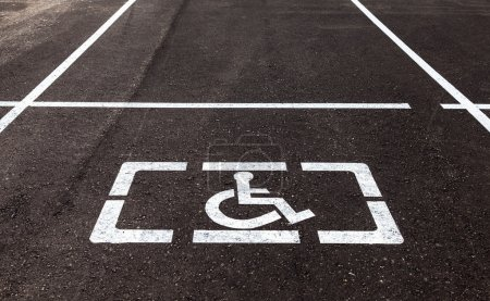 Photo for Parking places with handicapped or disabled signs and marking lines on asphalt - Royalty Free Image